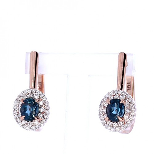Golden earrings with precious stones
