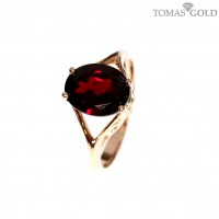 Golden ring with precious stones
