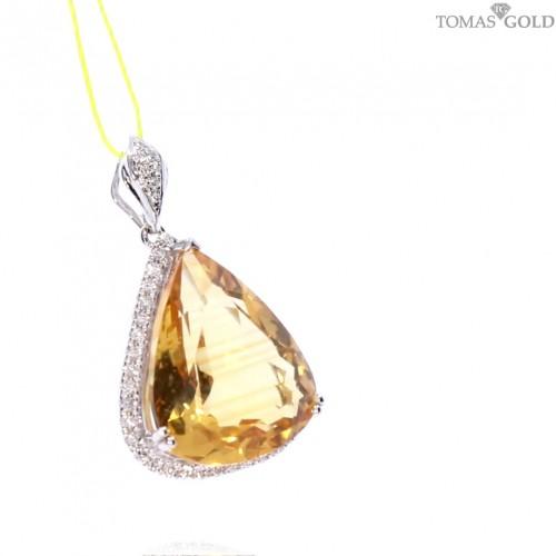 Golden pendant with precious stones